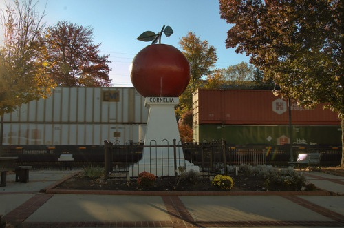 Cornelia GA Train Passing Big Apple Statue Monument Habersham County Photogaph Copyright Brian Brown Vanishing North Georgia USA 2014