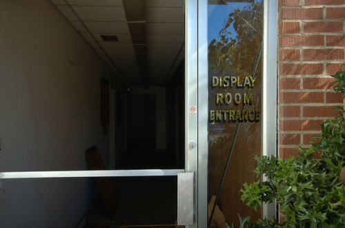 Toccoa Casket Company GA Display Room Entrance Vandalism Famous Local Industry Photograph Copyright Brian Brown Vanishing North Georgia USA 2014