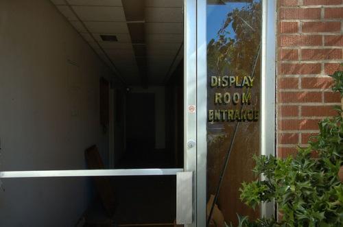 Toccoa Casket Company GA Display Room Entrance Vandalism Famous Local Industry Photograph Copyright Brian Brown Vanishing North Georgia USA 2014