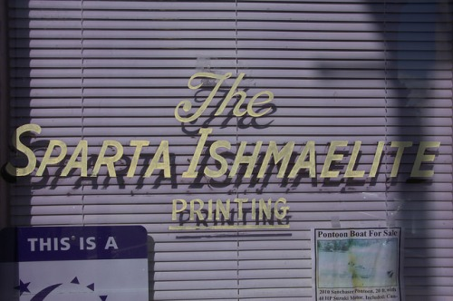 Sparta Ishmaelite Newspaper Window Sign Photograph Copyright Brian Brown Vanishing North Georgia USA 2014