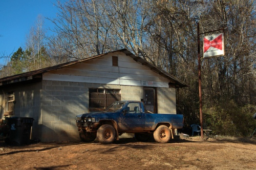 Meriwether GA Baldwin County Crisp Coed Outdoorsmen Hunting Club Clubhouse Budweiser Sign Toyota Truck Photograph Copyright Brian Brown Vanishing North Georgia USA 2015