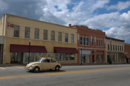 Historic Downtown Elberton GA Oliver Street Storefronts Old Volkswagen Beetle Photograph Copyright Brian Brown Vanishing North Georgia USA 2015